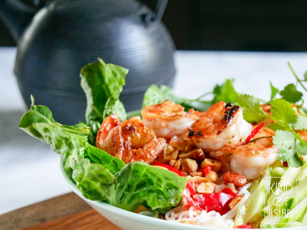 Ideal summer recipe: Vietnamese rice noodle salad with lemongrass shrimp, sweet and sour carrot, crispy lettuce and fresh herbs in Vietnamese dressing of lime, fish sauce, garlic and chili.