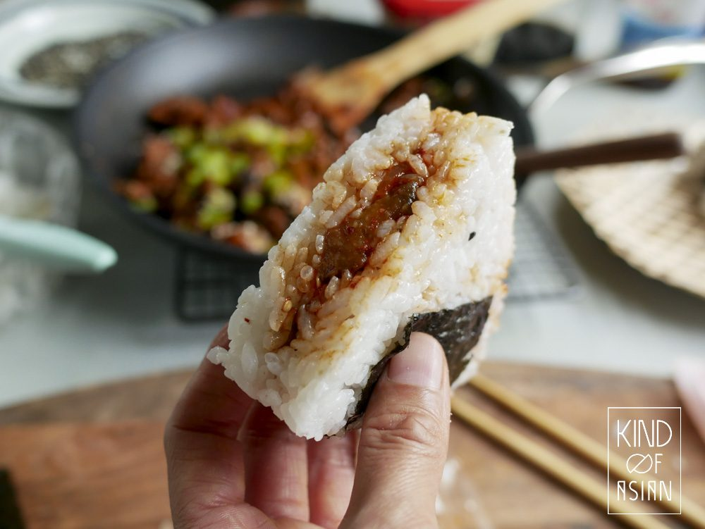 Soft and chewy rice from this vegan onigiri is filled with meaty and spicy eggplant and wrapped with salty nori.
