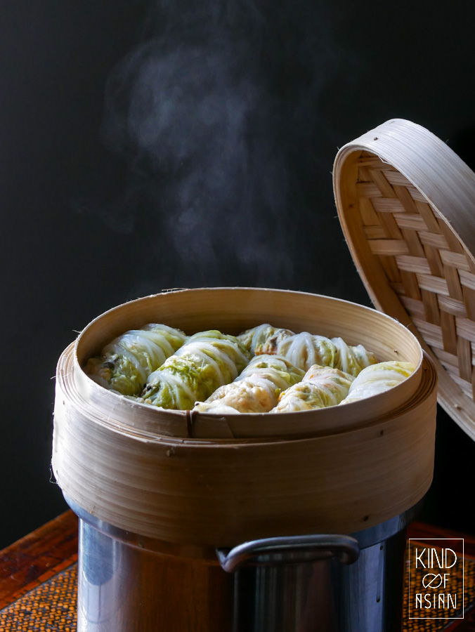 Chinese stuffed cabbage rolls steamed in a bamboo basket.