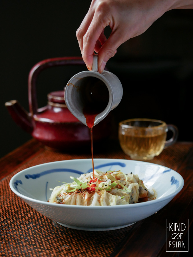 Steamed Chines stuffed cabbage rolls and spicy Sichuan red oil