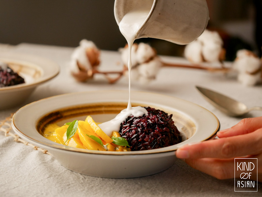 Steamed Thai black sticky rice with mango and coconut cream.
